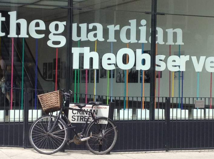 Window of the building housing The Guardian newspaper, London England.