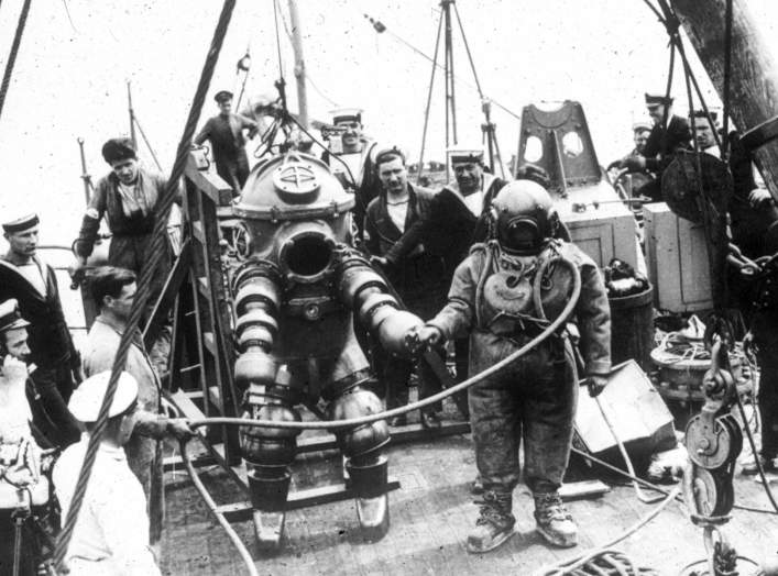 "J. Peress' 1-atm dive suit, Tritonia, explored the Lusitania wreck in 1935. Jim Jarrett was Peress's chief diver and made this dive to 312 feet. This suit was a precursor to the ""Jim"" suit, named for Jim Jarrett."