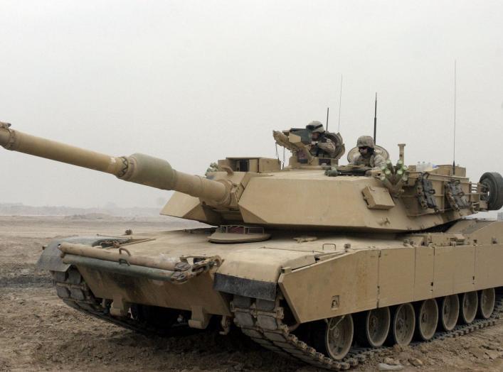 https://upload.wikimedia.org/wikipedia/commons/2/23/M1A1_Abrams_Tank_in_Camp_Fallujah.JPEG