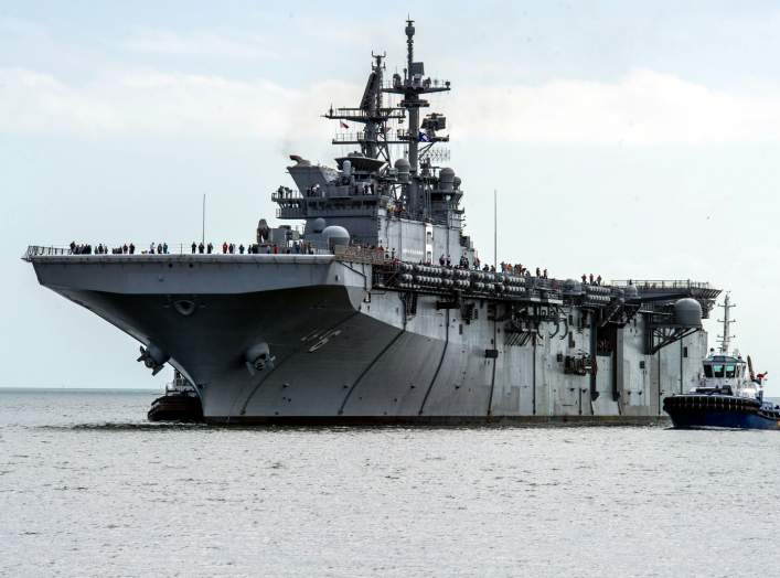 The U.S. Navy amphibious assault ship USS America (LHA-6) returns to Huntington Ingalls Shipyard, Pascagoula, Mississippi (USA), after completing sea trials.