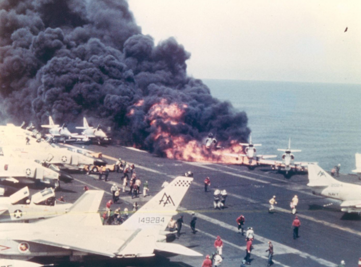In the first moments of the U.S.S. Forrestal disaster, an A-4 Skyhawk burns immediately after its fuel tank is ruptured by a Zuni rocket. 29 July 1967. U.S. Navy.