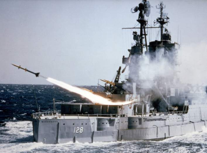 The U.S. Navy auxiliary USS Mississippi (EAG-128) fires an SAM-N-7 Terrier surface-to-air missile during at-sea tests, circa 1953-55. In 1962, the Terrier was redesignated RIM-2. Circa 1953-1955.