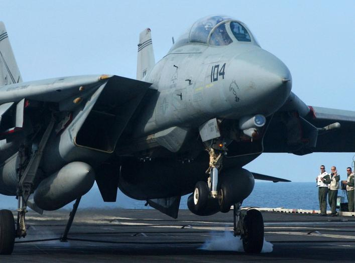 """Atlantic Ocean (July 14, 2005) – Landing Signal Officers watch as an F-14B Tomcat, assigned to the """"Swordsmen"""" of Fighter Squadron 32 (VF-32), catches an arresting wire with its tail hook aboard the Nimitz-class aircraft carrier USS Harry S. Truman (CVN 7"""