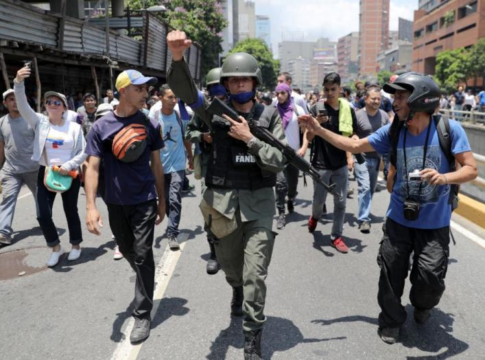 A Venezuelan National Guard member gestures, after joining anti-government protesters in a march, showing his support for opposition leader Juan Guaido in Caracas, Venezuela April 30, 2019. REUTERS/Manaure Quintero.