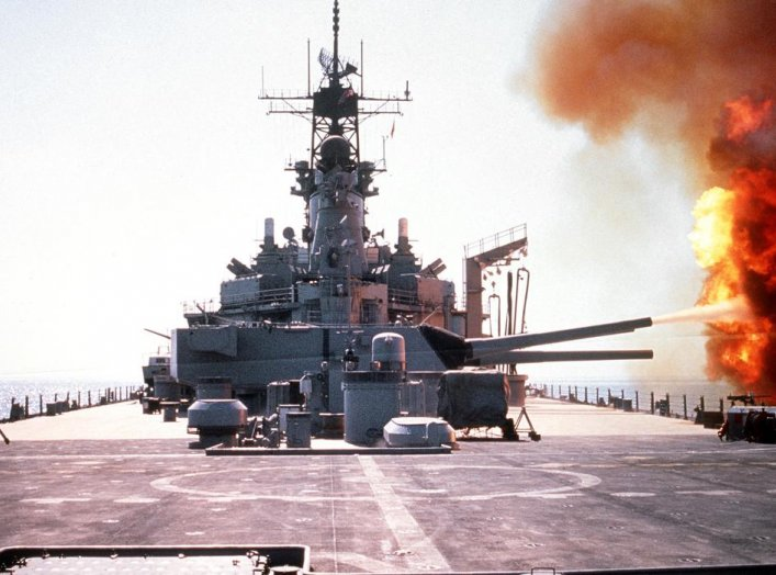 The battleship USS WISCONSIN (BB-64) fires a round from one of the Mark 7 16-inch/50-caliber guns in its No. 3 turret during Operation Desert Storm. 6 February 1991. U.S. Navy/John Carnes.