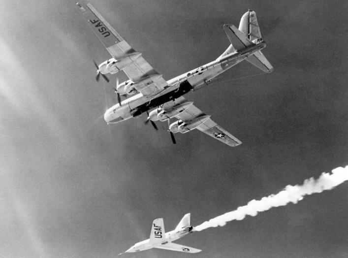 "The Bell Aircraft Company X-2 (46-674) drops away from its Boeing B-50 mothership in this photo. Lt. Col. Frank ""Pete"" Everest piloted 674 on its first unpowered flight on August 5 1954. He made the first rocket-powered flight on November 18, 1955. NASA."