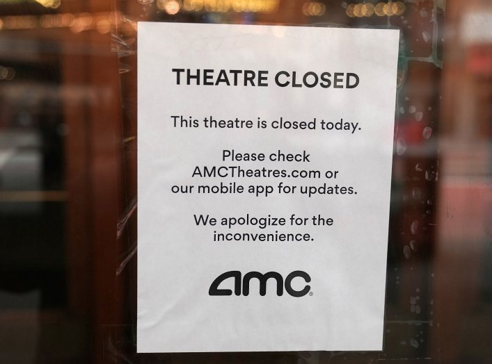 A sign is displayed on the window of a movie theater in Times Square following the outbreak of coronavirus disease (COVID-19), in the Manhattan borough of New York City, New York, U.S. March 17, 2020. REUTERS/Carlo Allegri