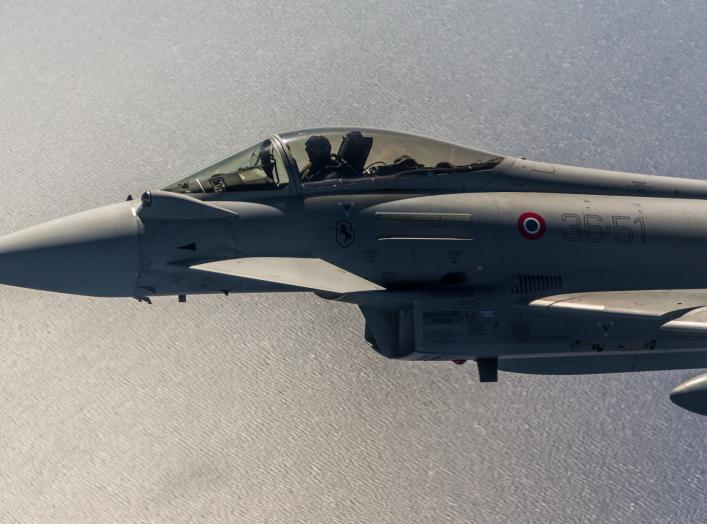 An Italian Eurofighter flies next to a Montenegrin Learjet 45 during a simulated interception exercise. A year on from Montenegro joining the Alliance, NATO has started air policing over the country.