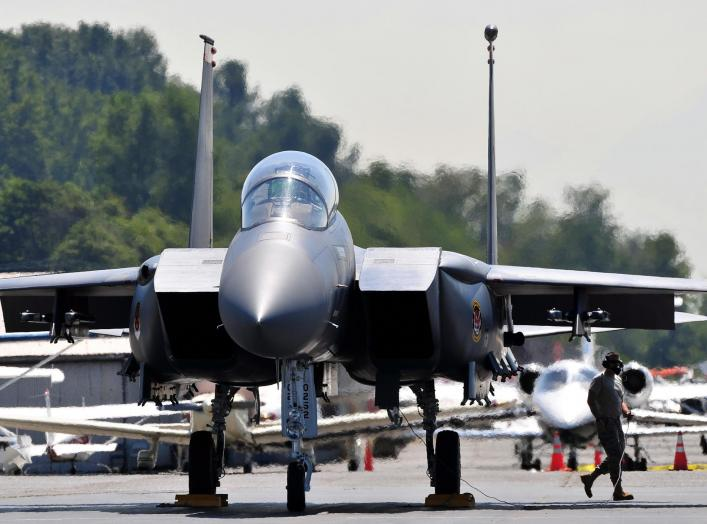 A crew chief from the 391st Aircraft Maintenance Unit finishes checking an F-15E Strike Eagle from the 391st Fighter Squadron before it performs at the Seafair Hydroplane Races and Air Show in Seattle July 30 through Aug. 2, 2010.