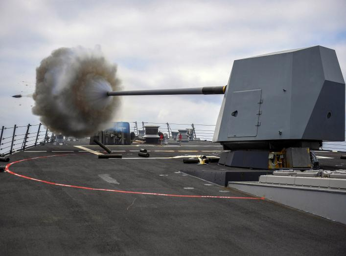 The Arleigh Burke-class guided-missile destroyer USS Bainbridge (DDG 96) fires its Mark 45 five-inch gun during a live-fire exercise. Bainbridge, homeported at Naval Station Norfolk, is conducting naval operations in the U.S. 6th Fleet area of operations