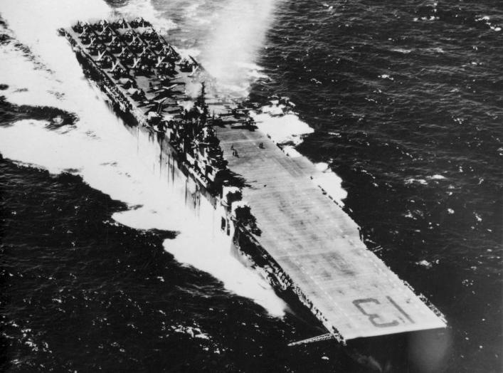 The U.S. Navy aircraft carrier USS Franklin (CV-13) underway with aircraft of Carrier Air Group 13 (CVG-13) on deck. Between May 1944 and November 1944, Franklin was the only carrier wearing two different camouflage schemes, Measure 32 Design 3A on the po