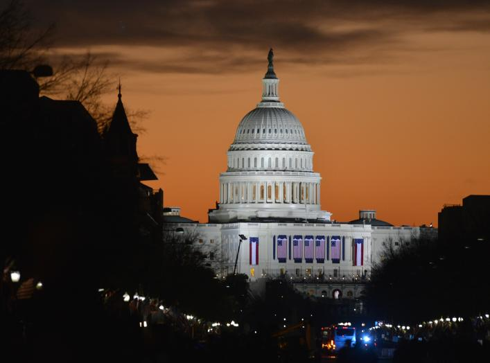 The sun rises over the U.S. Capitol before the public swearing-in ceremony during the 57th Presidential Inauguration in Washington, D.C, Jan. 21, 2013.