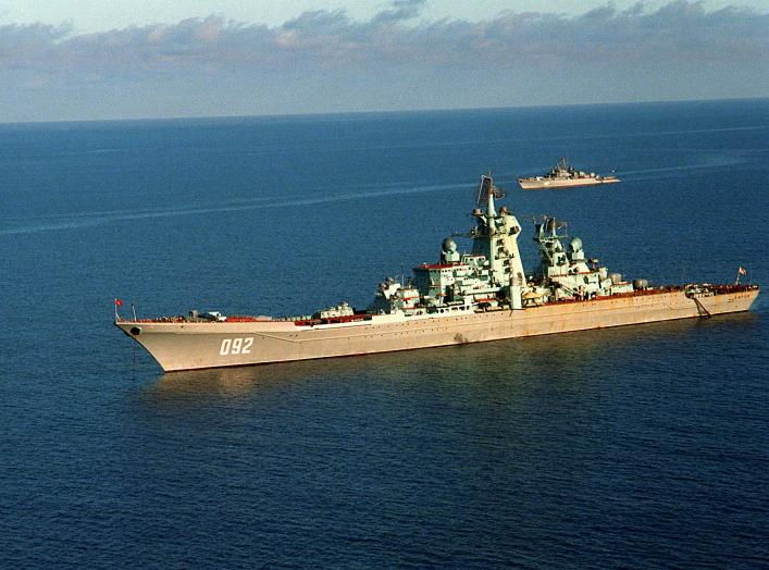 A port view of the Soviet nuclear-powered guided missile cruiser KIROV at anchor. In the background is a Soviet Krivak I-class guided missile frigate.
