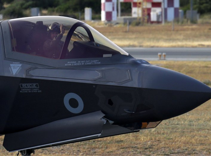 A pilot in a F-35B aircraft waves after landing at the Akrotiri Royal Air Forces base before landing, near city of Limassol