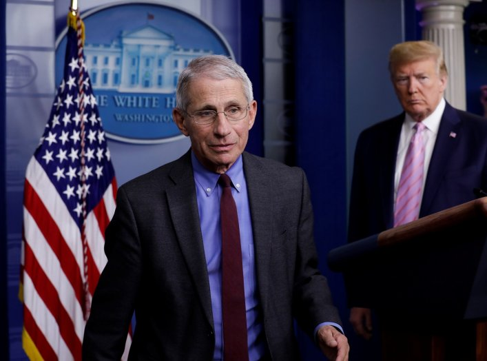 National Institute of Allergy and Infectious Diseases director Dr. Anthony Fauci turns the podium over to U.S. President Donald Trump during the coronavirus response daily briefing at the White House in Washington, U.S., April 10, 2020. REUTERS/Yuri Gripa