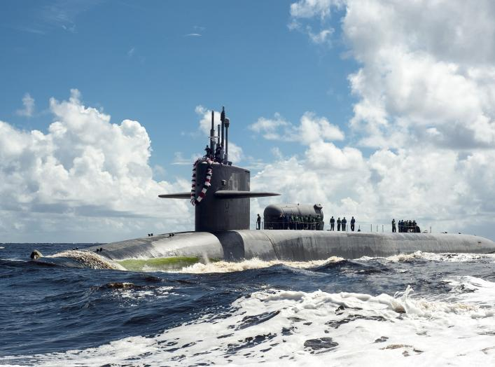 The Ohio-class guided-missile submarine USS Georgia (SSGN 729) transits the Saint Marys River.