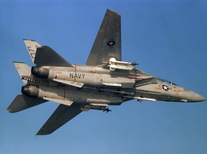 A U.S. Navy Grumman Grumman F-14A-85-GR Tomcat (BuNo 159595) from fighter squadron VF-143 Pukin' Dogs in flight on 20 April 1987, armed with three AIM-7 Sparrow and four AIM-9L Sidewinder air-to-air missiles