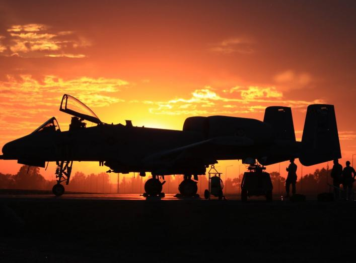 Airmen from the Maryland National Guard's 175th Wing load weapons on an A-10C at sunset. (Photo courtesy of the 175th Wing)