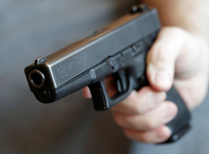 A gun owner displays a Glock 20, 10 mm Auto pistol in Vienna, Austria, March 22, 2018. REUTERS/Heinz-Peter Bader