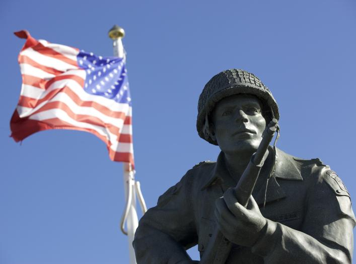 The statue of Maj. Dick Winters of Easy Company, 506th Parachute Infantry Regiment, 101st Airborne Division, stands as reminder of the sacrifice of the Greatest Generation near Utah Beach, Normandy, France, June 7, 2015. Over 380 service members from Euro