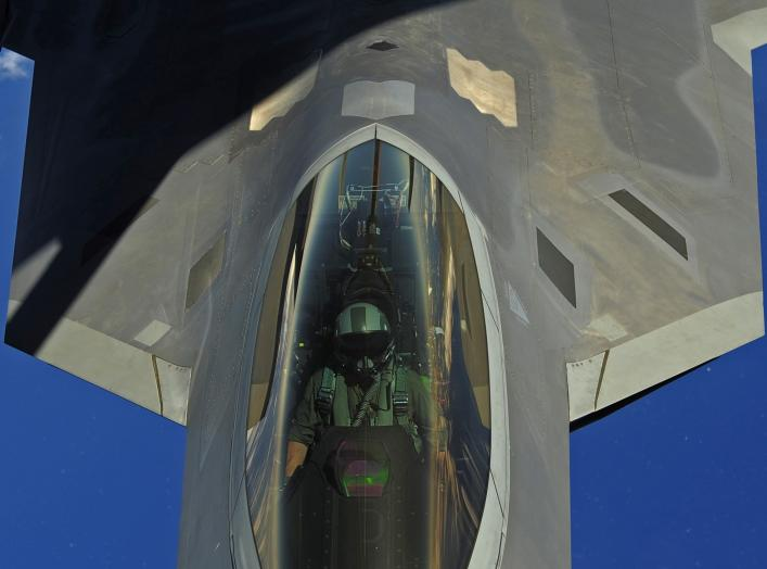 A U.S. Air Force F-22 Raptor pilot assigned to the 90th Fighter Squadron, Elmendorf Air Force Base, Alaska, receives fuel from a KC-135 Stratotanker with the 465 Air Refueling Squadron out of Tinker Air Force Base, Okla
