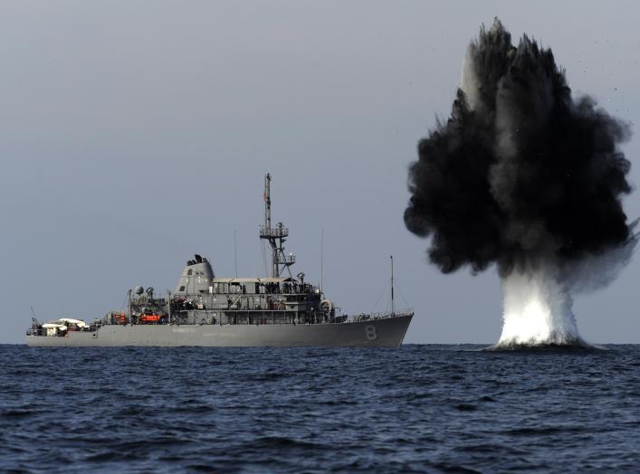 STRAIT OF HORMUZ (Nov. 19, 2010) A demolition charge detonates 1,500 meters from the Avenger-class mine countermeasures ship USS Scout (MCM 8).