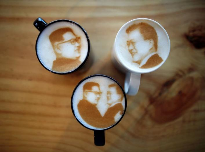 Pictures of North Korean leader Kim Jong Un and South Korean President Moon Jae-in are printed on top of milk foam of lattes at a coffee shop in Jeonju, South Korea, June 1, 2018. Picture taken June 1, 2018. REUTERS/Kim Hong-Ji