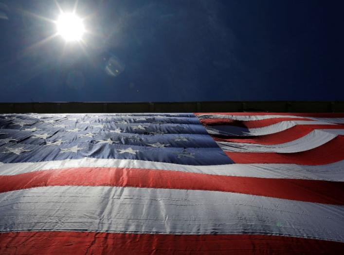 "As 95-by-50-foot American flag is unfurled on the side of an apartment complex, a replica of the ""The Great Flag"" that was spun, woven, dyed, constructed and displayed on the same building by Amoskeag Manufacturing Company in 1914, in Manchester, New Hamp"