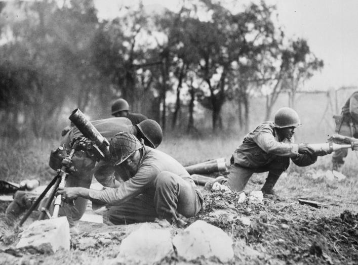 Members of a mortar company of the 92nd Division pass the ammunition and heave it over at the Germans in an almost endless stream near Massa, Italy. This company is credited with liquidating several machine gun nests. Wikimedia Commons