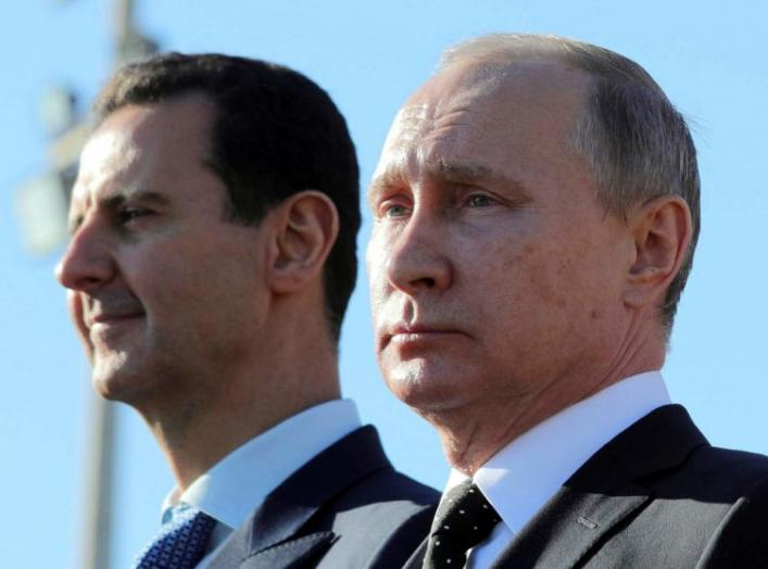 Russian President Vladimir Putin (R) and Syrian President Bashar al-Assad visit the Hmeymim air base in Latakia Province, Syria December 11. REUTERS/File Photo