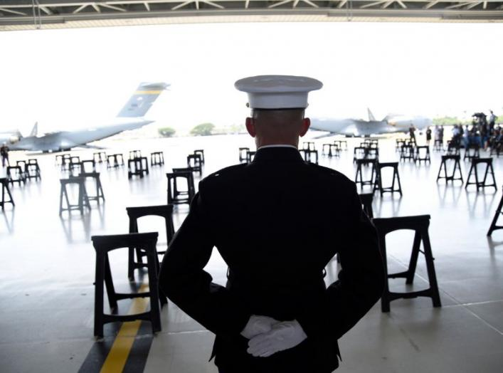 A U.S. Marine stands as caskets containing the remains of American servicemen from the Korean War handed over by North Korea arrive at Joint Base Pearl Harbor-Hickam in Honolulu, Hawaii, U.S., August 1, 2018. REUTERS/Hugh Gentry