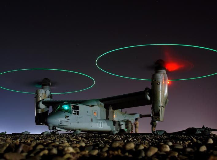 Crew members refuel an MV-22 before a night mission in Iraq, 2008