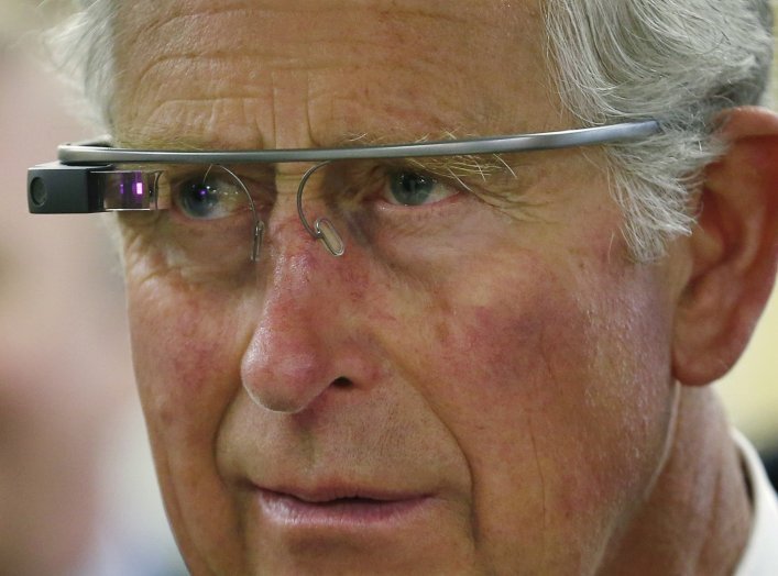 Britain's Prince Charles trys a pair of Google glasses to uses software developed at an innovation center in Winnipeg, Manitoba, May 21, 2014. The royal couple are on a four-day visit to Canada that began in Halifax and includes stops in Pictou, Nova Scot