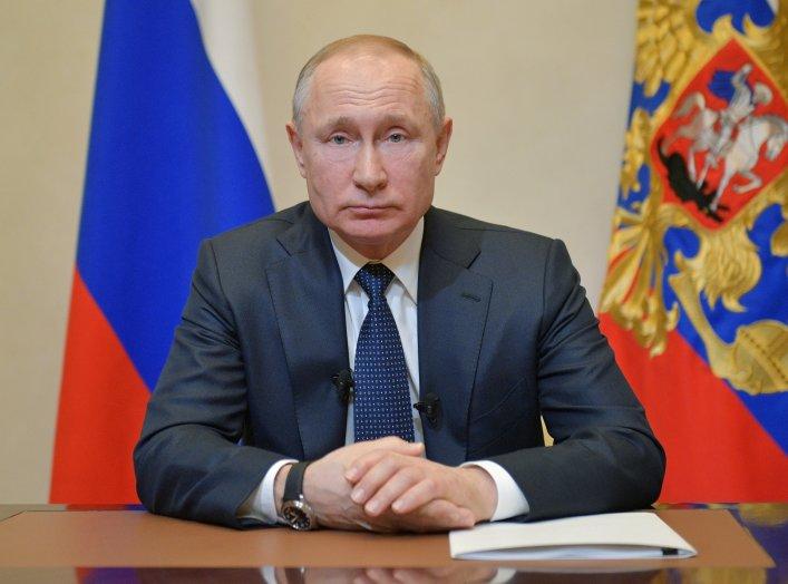 Russian President Vladimir Putin addresses the nation on the coronavirus disease (COVID-19) outbreak in a televised speech in Moscow, Russia March 25, 2020. Sputnik/Alexei Druzhinin/Kremlin via REUTERS