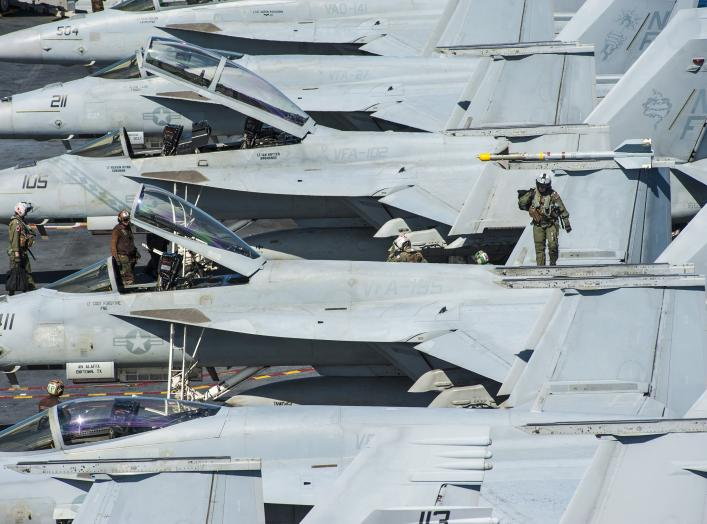 U.S. Sailors prepare for flight operations on the aircraft carrier USS George Washington (CVN 73) in the East China Sea July 28, 2014.