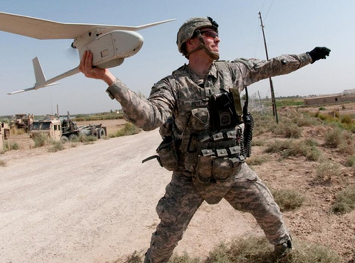 Army 1st Lt. Steven Rose launches an RQ-11 Raven unmanned aerial vehicle near a new highway bridge project along the Euphrates River north of Taqqadum, Iraq, Oct. 9, 2009. U.S. Army photo by Spc. Michael J. MacLeod