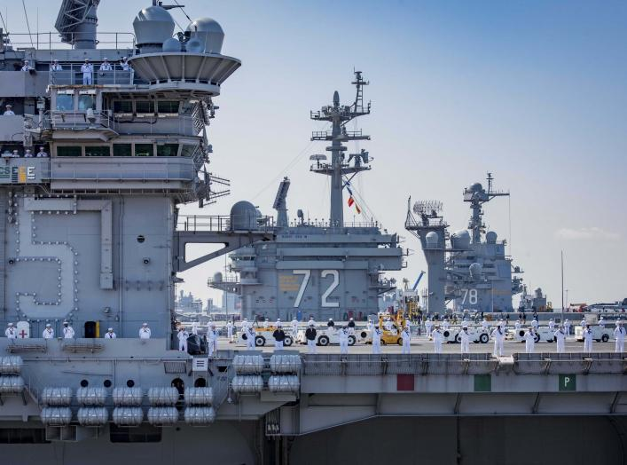 NORFOLK (April 11, 2018) Sailors aboard the aircraft carrier USS Harry S. Truman (CVN 75) man the rails during departure for the ship's 2018 deployment.