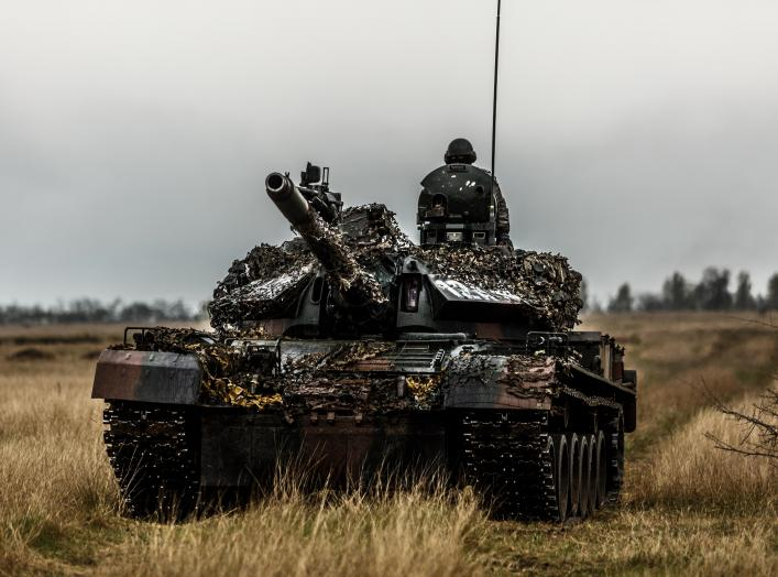 A Romanian TR-85 tank and tanker on a training ground in Romania. US troops are currently on deployment in Romania as part of Operation Atlantic Resolve.