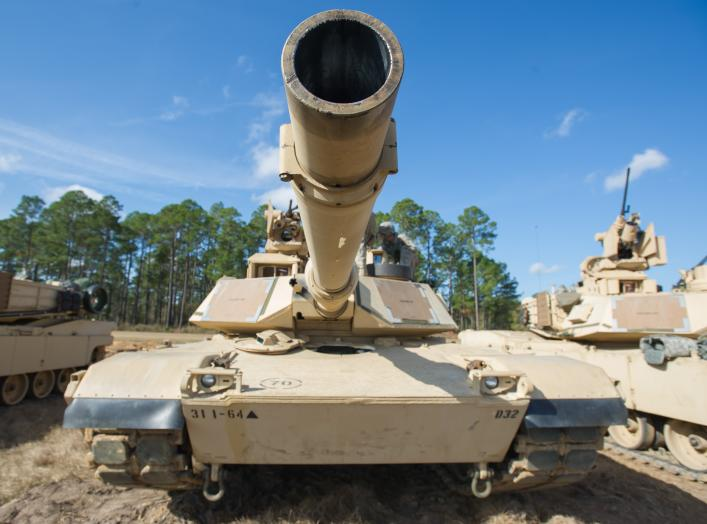 "An M1A2SEP Abrams tank from Company D, 1st Battalion, 64th Armor Regiment ""Desert Rogues,"" 2nd Armored Brigade Combat Team, 3rd Infantry Division, sits ready for the days activities here at Red Cloud Range, Dec. 6."