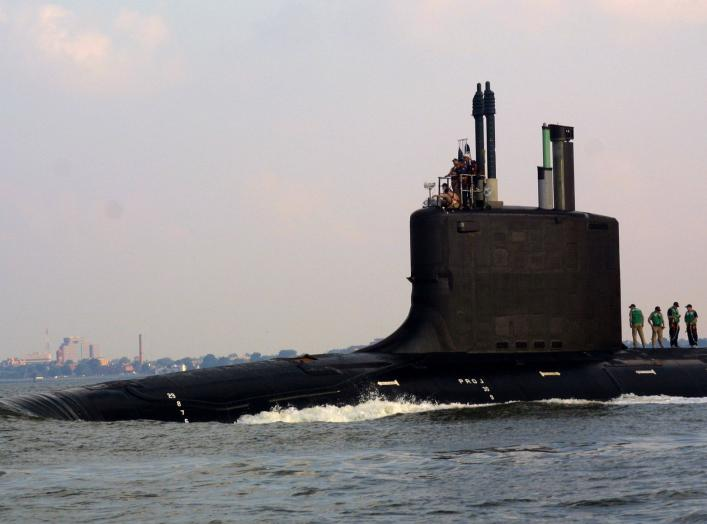The nation's newest and most advanced nuclear-powered attack submarine PCU Virginia (SSN 774) passes the skyline of Hampton, Va., with the campus of Hampton University seen in the background, on its the way to Norfolk Naval Shipyard upon completion of Bra