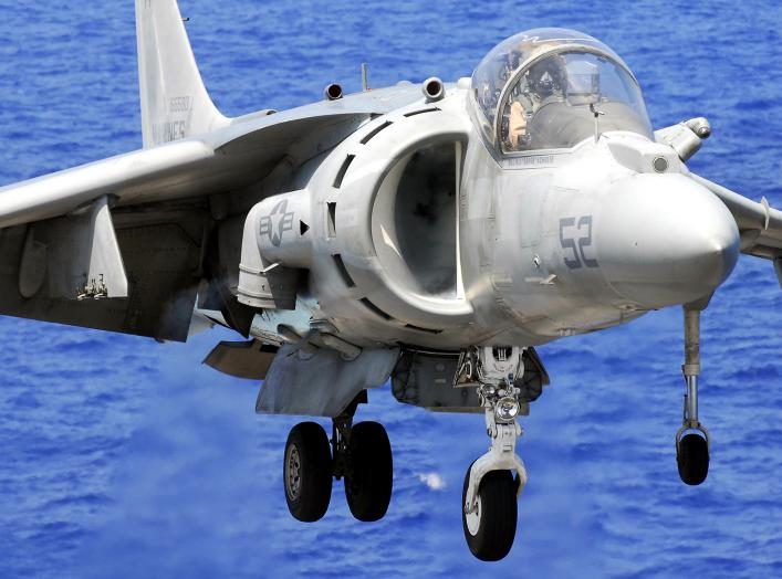 U.S. Marine Corps Maj. M. J. Shulte lands an AV-8B Harrier aircraft on the flight deck of the amphibious assault ship USS Peleliu (LHA 5), while under way in the Pacific Ocean.