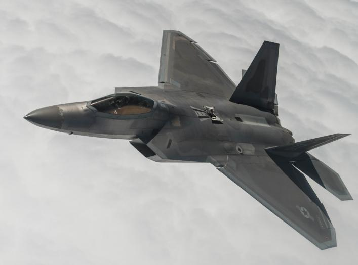 Capt. Chris Batterton aggressively banks his F-22A Raptor during a basic fighting maneuver training mission off the Virginia coast last week. The captain is with the 27th Fighter Squadron, the Air Force's first unit to fly the Raptor.