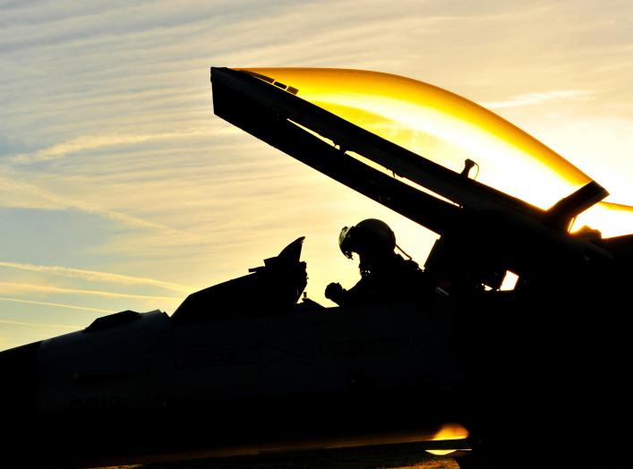 A U.S. Air Force pilot with the 480th Fighter Squadron (FS) performs a preflight functions check on an F-16 Fighting Falcon aircraft before leaving for Nordic Air Meet 2012 at Spangdahlem Air Base, Germany, Aug. 23, 2012.