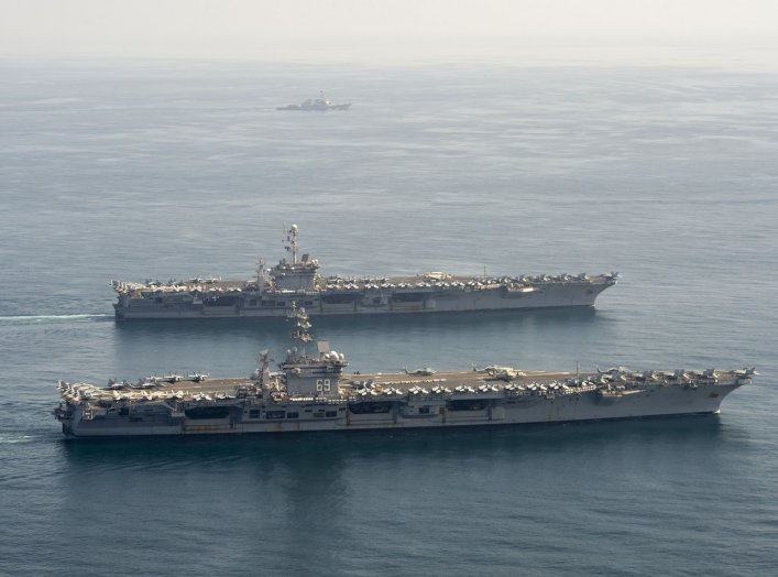 ARABIAN SEA (March 18, 2020) The aircraft carriers USS Dwight D. Eisenhower (CVN 69), front, and USS Harry S. Truman (CVN 75), and the guided-missile destroyer USS Lassen (DDG 82) transit the Arabian Sea, March 18, 2020. The Harry S. Truman Carrier Strike