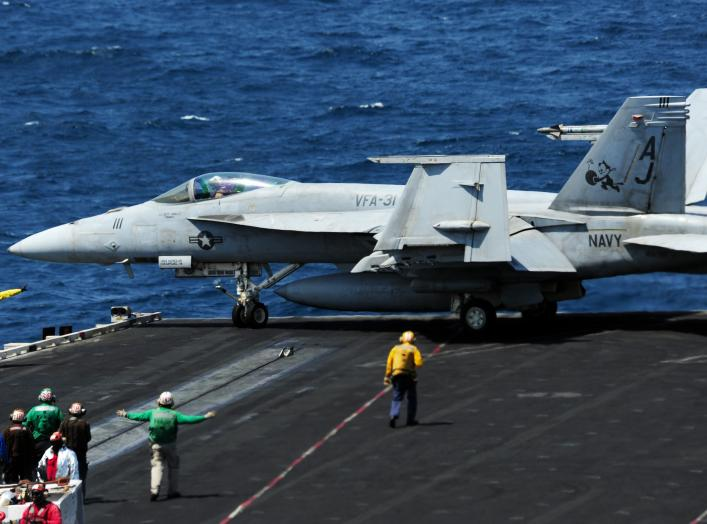 ARABIAN GULF (Sept. 11, 2014) Sailors direct an F/A-18E Super Hornet attached to the Tomcatters of Strike Fighter Squadron (VFA) 31 on the flight deck of the aircraft carrier USS George H.W. Bush.