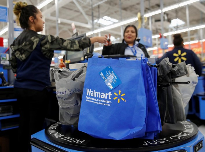 A customer pays for her groceries after shopping at a Walmart store ahead of the Thanksgiving holiday in Chicago, Illinois, U.S. November 27, 2019. REUTERS/Kamil Krzaczynski