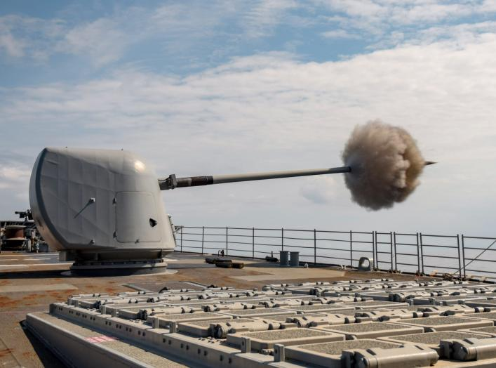 ADRIATIC SEA (June 6, 2018) The guided-missile cruiser USS Normandy (CG 60) fires its Mark 45 5-inch gun during a live-fire exercise. Normandy is deployed as part of the Harry S. Truman Carrier Strike Group