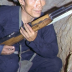 Viet Cong insurgent crouching in a bunker holding an SKS rifle. (U.S. Air Force photo).