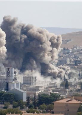 Smoke rises after an U.S.-led air strike in the Syrian town of Kobani Ocotber 8, 2014. U.S.-led air strikes on Wednesday pushed Islamic State fighters back to the edges of the Syrian Kurdish border town of Kobani, which they had appeared set to seize afte