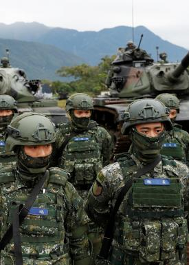 Taiwanese soldiers stand in front of M60A3 tanks during a military drill in Hualien, eastern Taiwan, January 30, 2018. REUTERS/Tyrone Siu